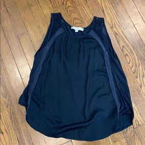 Gorgeous, navy sleeveless top with lace details.